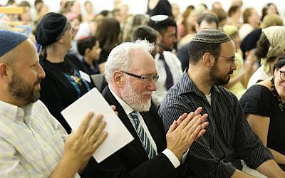 Rabbi Daniel Landes, center, surrounded by his students at a June 7, 2016, private ordination ceremony in Jerusalem. (Naama Marinberg)