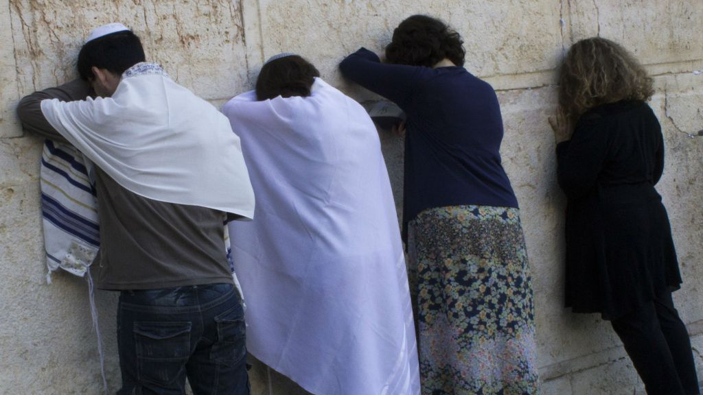 Conservative Jews pray at the temporary egalitarian Robinson's Arch prayer pavilion at the southern end of the Western Wall in Jerusalem's Old City on July 30, 2014. (Robert Swift/Flash90)