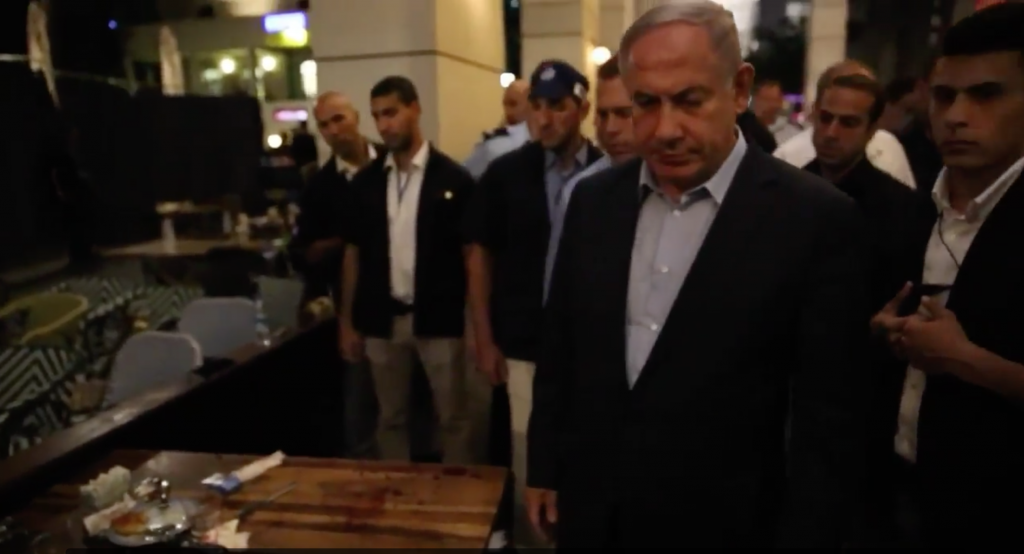 Prime Minister Benjamin Netanyahu visits the scene of a terror attack on Tel Aviv's Sarona Market on June 9, 2016. (Prime Minister's Office)