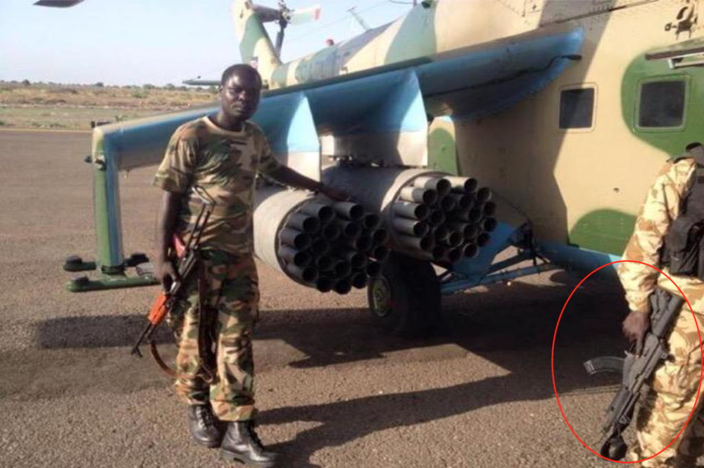 A South Sudanese soldier, right, holds a Galil ACE rifle, made by Israel Weapons Industries (circled in red), alongside another soldier holding what appears to be an AK-47 assault rifle. (United Nations)