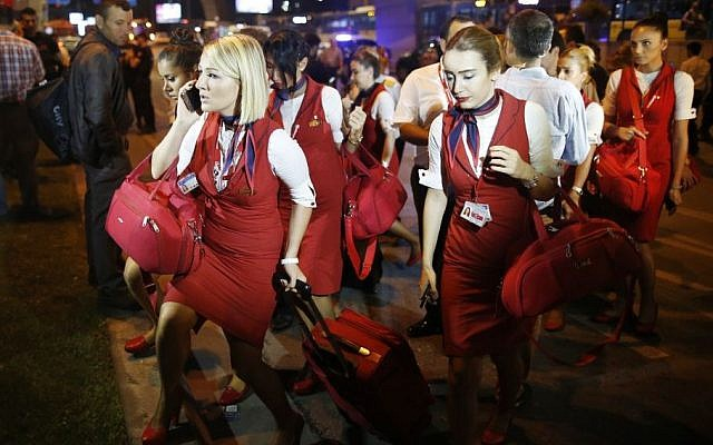 Members of a flight crew leave Istanbul's Ataturk airport, early Wednesday, June 29, 2016.  (AP/Emrah Gurel)