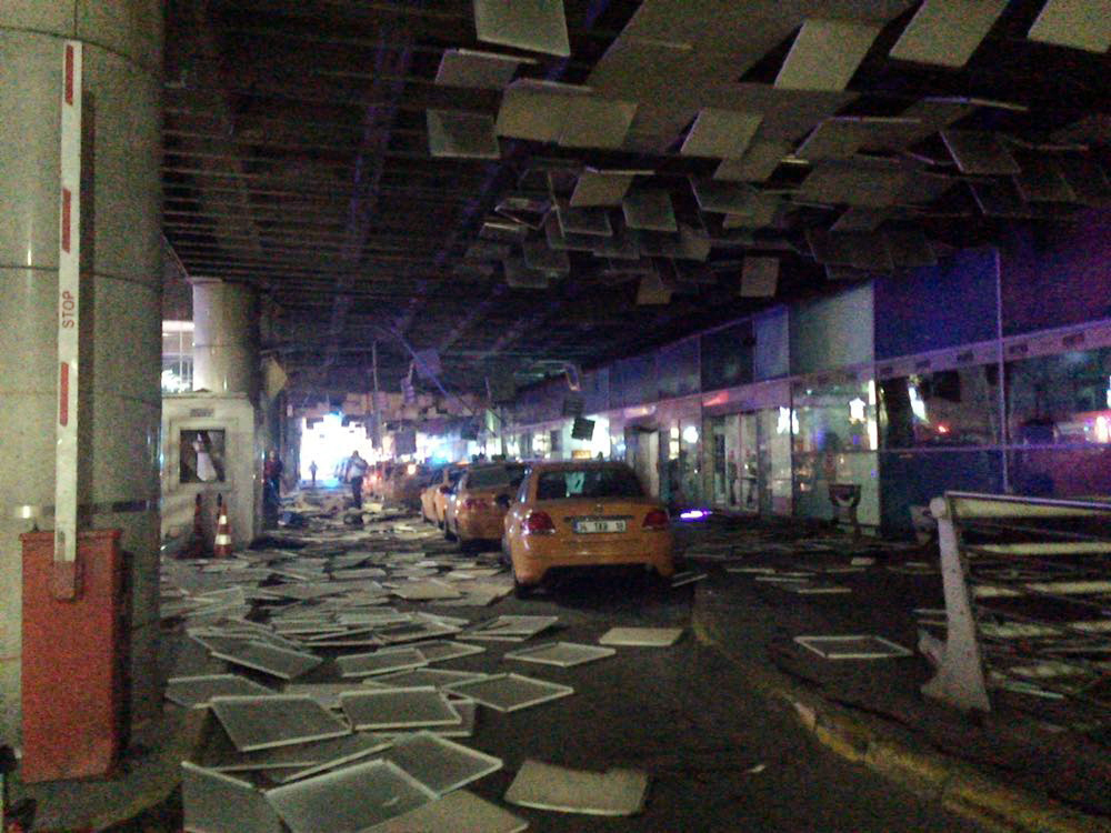 An entrance of the Ataturk Airport in Istanbul after explosions, Tuesday, June 28, 2016. (DHA via AP)