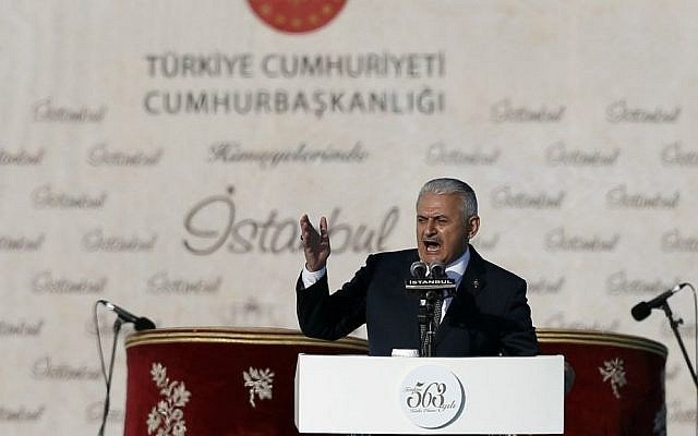 Turkey's new Prime Minister Binali Yildirim addresses onlookers during celebrations marking the 563rd anniversary of the Ottoman conquest of Constantinople, now Istanbul, in Istanbul, Turkey, Sunday, May 29, 2016. (AP Photo/Emrah Gurel)