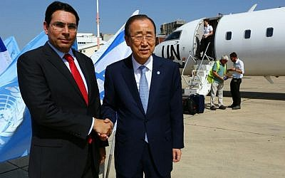 Israel's Ambassador to the UN, Danny Danon, greets UN Secretary-General Ban Ki-moon on his arrival in Israel, June 27, 2016 (Avi Davidi)