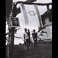 A photo of Prime Minister Levi Eshkol hangs in Libera in honor of his visit in June, 1966. (Moshe Fridan/GPO)