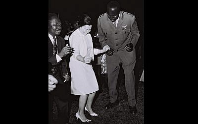 Miriam Eshkol, wife of Prime Minister Levi Eshkol, dancing with then Ugandan foreign minister Sam Odaka and army chief (and later president) Idi Amin on a visit to an army base outside Kampala, June, 1966. (GPO)