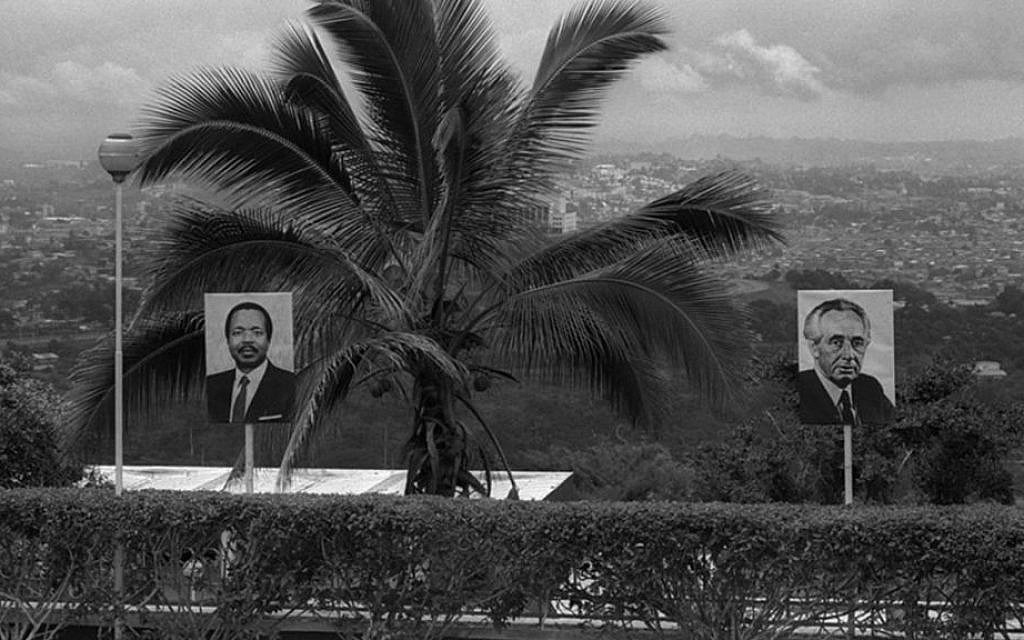 Images of Prime Minister Shimon Peres and Cameroonian President Paul Biya decorate the road to Yaoundé, Cameroon's capital city, August 25, 1986. (Nati Harnik/GPO)