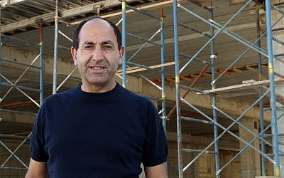 Rami Levy at the construction site for his new mall in Atarot, Jerusalem, taken June 21, 2016. ( Luke tress / Times of Israel)