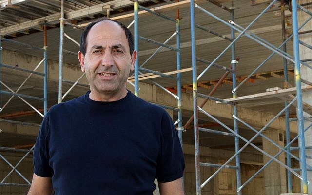 Rami Levy at the construction site for his new mall in Atarot, Jerusalem, June 21, 2016. ( Luke tress/Times of Israel)