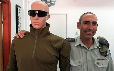 Lt. Col. Liron Segal, head of the IDF's Personal Protective Equipment Branch, displays a new uniform and pair of protective eyewear developed by the unit. (Luke Tress/Times of Israel)