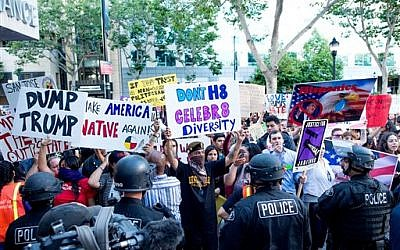 Police form a line to contain protesters outside a campaign rally for Republican presidential candidate Donald Trump on Thursday, June 2, 2016, in San Jose, Calif.  (AP Photo/Noah Berger)