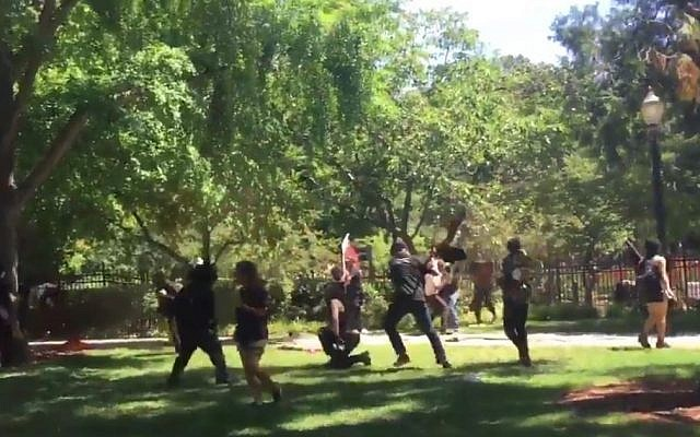 Clashes outside the California state Capitol Building in Sacramento on June 26, 2016. (screen capture: Twitter/Frances Wang)