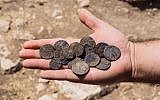 Cache of silver coins found at an estate house in Modiin, June 7, 2016. (Assaf Peretz, courtesy of the Israel Antiquities Authority)