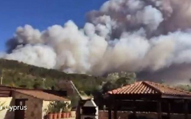 A forest fire rages near the Cypriot village of Argaka in the Paphos region on June 18, 2016. (screen capture: Twitter via James Archer)