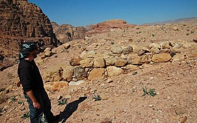 This undated handout image, provided by Dr. Christopher A. Tuttle, executive director of the Council of American Overseas Research Centers, shows him standing at the southwest corner of the interior, smaller platform, looking north, in Petra, Jordan. (Council of American Overseas Research Centers/ Q. Tweissi via AP)