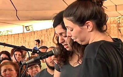 The daughters of Ilana Naveh, one of the four victims of the Sarona Market attack in central Tel Aviv on June 8, 2016, speak at her funeral in Petah Tikva on June 10, 2016. (Screenshot/Channel 2)