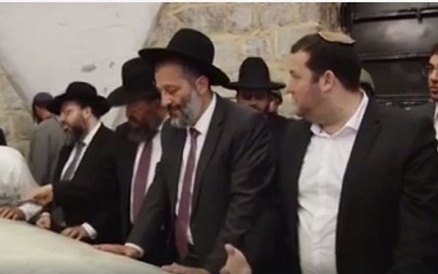 Interior Minister Aryeh Deri prays at Joseph's Tomb, a Jewish holy site east of the West Bank city of Nablus on June 1, 2016. (screen capture: Facebook)