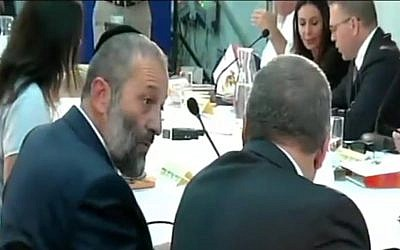 Interior Minister Aryeh Deri speaks to Defense Minister Avigdor Liberman, in comments that were caught on camera on June 2, 2016 (Channel 2 News)