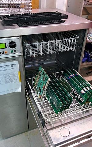 CERN's dishwasher for circuit boards was viewed over 121,000 times on Facebook and retweeted on Twitter (Courtesy)