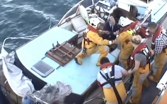 Members of the Royal National Lifeboat Institution at Dover in action (screen capture: YouTube)