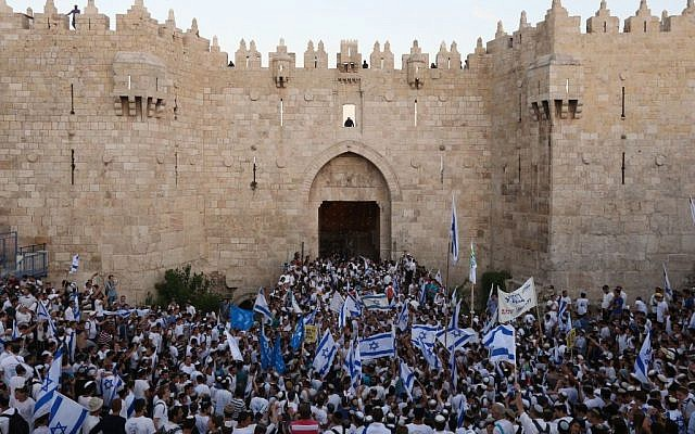 Illustrative: Thousands of Israeli wave the national flag as they celebrate Jerusalem Day, dancing and marching their way through Damascus Gate to the Western Wall, in the Old City of Jerusalem, May 17, 2015. (Yonatan Sindel/Flash90)
