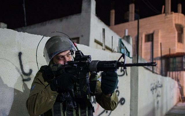 Illustrative: An Israeli soldier during an operation near Bethlehem in the West Bank on December 8, 2015. (Nati Shohat/Flash90)