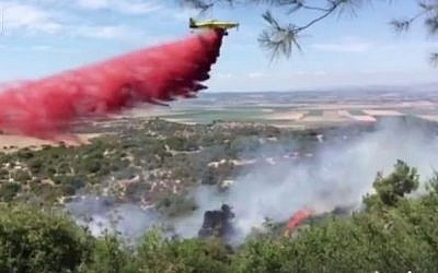 Firefighters fighting a blaze near the Megiddo Junction in northern Israel on June 11, 2016. (Screen capture: Facebook)