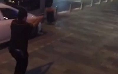 A still from a video captured by a passerby with a phone shows security guard A. in pursuit of a terrorist at Tel Aviv's Sarona Market on Wednesday, June 8, 2016. (Screen capture Ynet)