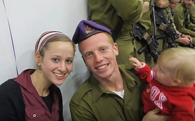 Yehuda Yitzhak HaYisraeli, an Israeli soldier badly hurt in the 2014 Gaza war, with his wife and son, before his injury (YouTube screenshot)