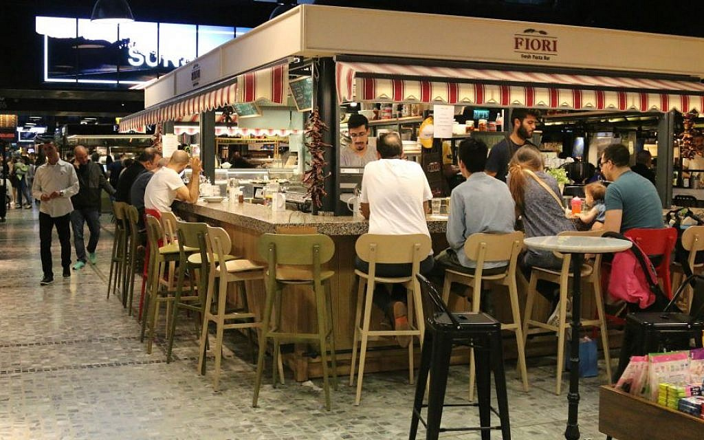 Sarona's indoor market area is popular with residents and tourists. (Shmuel Bar-Am)