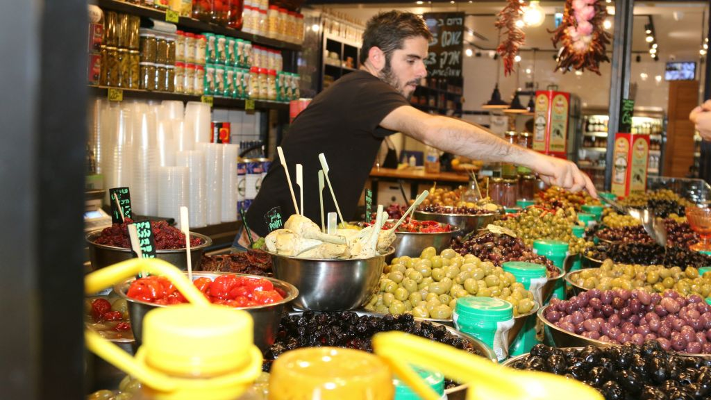 The indoor market hosts 91 shops and eateries. (Shmuel Bar-Am)
