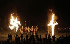 In this Saturday, April 23, 2016 photo, members of the Ku Klux Klan participate in cross and swastika burnings after a 'white pride' rally in rural Paulding County near Cedar Town, Georgia. (AP Photo/Mike Stewart)