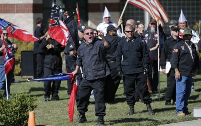 "Members of the Ku Klux Klan participate in a ""white pride"" rally in Rome, Georgia, April 23, 2016. (AP Photo/John Bazemore)"