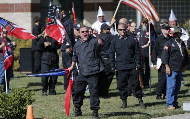 "Members of the Ku Klux Klan participate in a ""white pride"" rally in Rome, Georgia, April 23, 2016. (AP Photo/John Bazemore)"