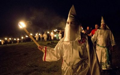 Illustrative: In this Saturday, April 23, 2016 photo, members of the Ku Klux Klan participate in cross burnings after a 'white pride' rally in rural Paulding County near Cedar Town, Georgia. (AP Photo/John Bazemore)