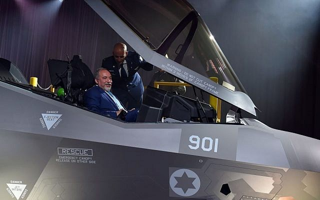 Defense Minister Avigdor Liberman sits in the cockpit of the F-35 stealth fighter jet, as IAF Chief of Staff Brig. Gen. Tal Kelman stands over him, during an unveiling ceremony in Fort Worth, Texas, on June 22, 2016. (Ariel Hermoni/Defense Ministry)