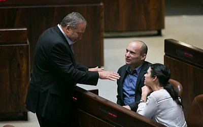 Yisrael Beytenu leader Avigdor Liberman seen with Jewish Home head Naftali Bennett during a plenum session and vote on expanding the number of ministers in the newly forming government, May 11, 2015. (Miriam Alster/Flash90)