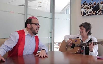Hasidic singer Lipa Schmeltzer with Israeli composer Corinne Allal (YouTube screenshot)