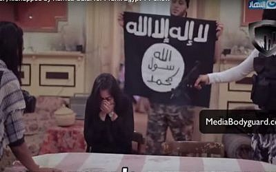 Heba Magdi, an Egyptian actress, cowers in fear as TV pranksters  dressed up as Islamic State terrorists stage a mock kidnap, June 2016    Screenshot)