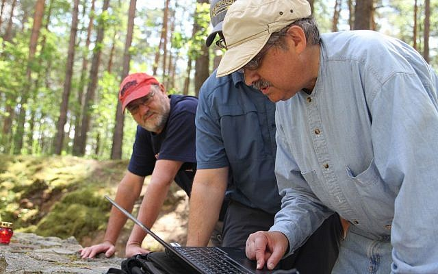 Prof. Richard Freund discusses ERT results with his team in the Ponar forest, outside Vilnius, Lithuania. (Ezra Wolfinger, NOVA)