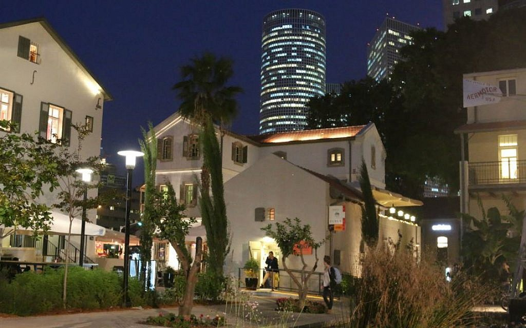 Sarona market at night, with Tel Aviv's ultra-modern Azraeli tower in the background. (Shmuel Bar-Am)