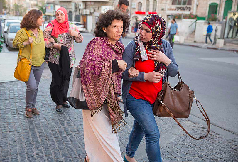 Annie Kurland and a fellow teacher walking through Jerusalem's Mahane Yehuda market in 2016, as part of the Teachers' Room coexistence project (Courtesy Dana Talel)