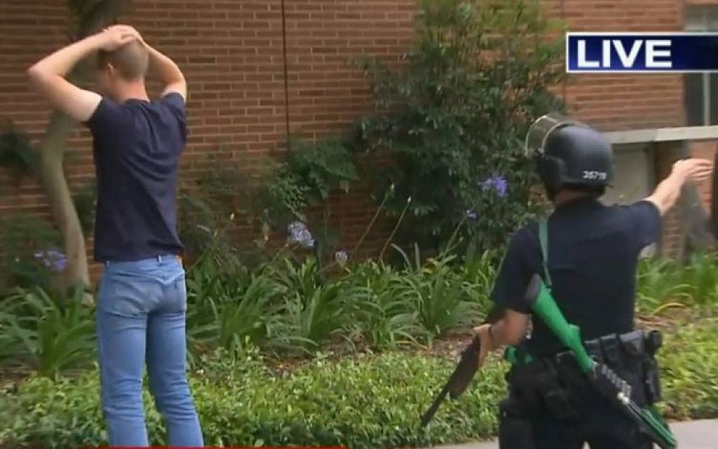 Police searching a man on the UCLA campus after a shooting on June 1, 2016. (screen capture: KTLA)
