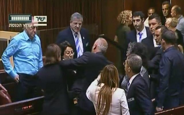 Joint (Arab) List MK Hanin Zoabi, center, rows with fellow lawmakers in the Knesset plenum over her comments on the Israel-Turkey reconciliation agreement on June 29, 2016 (screen capture: Knesset Channel)