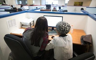 Illustrative: Ultra-Orthodox Jewish women work on computers at their desks in the Comax software company office in the central city of Holon near Tel Aviv, on April 17, 2016. (AFP Photo/Menahem Kahana)