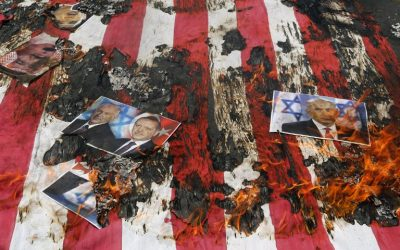 Portraits of Bahraini King Hamad (top L), Israeli Minister Benjamin Netanyahu and Turkish President Recep Tayyip Erdogan lie on a US flag in flames during a parade marking al-Quds (Jerusalem) Day in Tehran on July 1, 2016. (Atta Kenare/AFP)