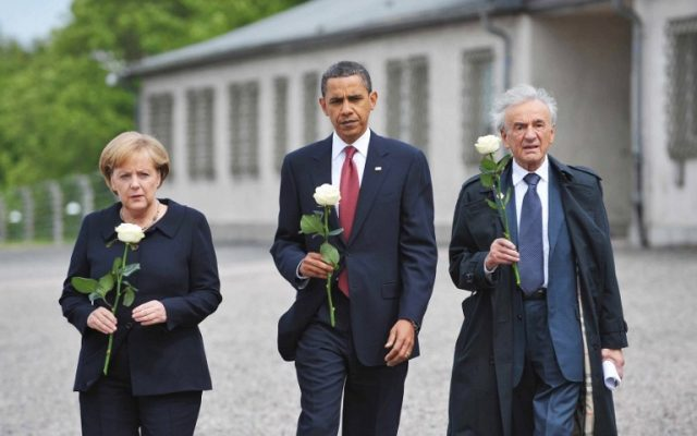 This June 5, 2009 photo shows US President Barack Obama (C), German Chancellor Angela Merkel and Holocaust survior Elie Wiesel making their way to pay their respects at a memorial during a visit to the former Buchenwald concentration camp near Weimar in Germany. (AFP PHOTO / MANDEL NGAN)