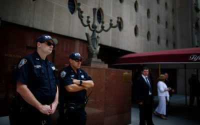 New York Police Department (NYPD) officers stand guard outside the synagogue as funeral services are held for Nobel laureate and Holocaust survivor Elie Wiesel in New York, July 3, 2016. (AFP/Kena Betancur)