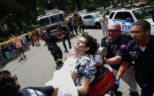 A critically injured man lies on a stretcher after an explosion at Central Park in New York on July 3, 2016. The New York Police Department (NYPD) said one person was injured. No further details were immediately available. (AFP PHOTO / KENA BETANCUR)