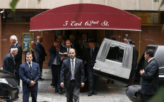 People exit the Fifth Avenue Synagogue during the funeral for Nobel laureate and Holocaust survivor Elie Wiesel on July 3, 2016 in New York. (AFP PHOTO / KENA BETANCUR)